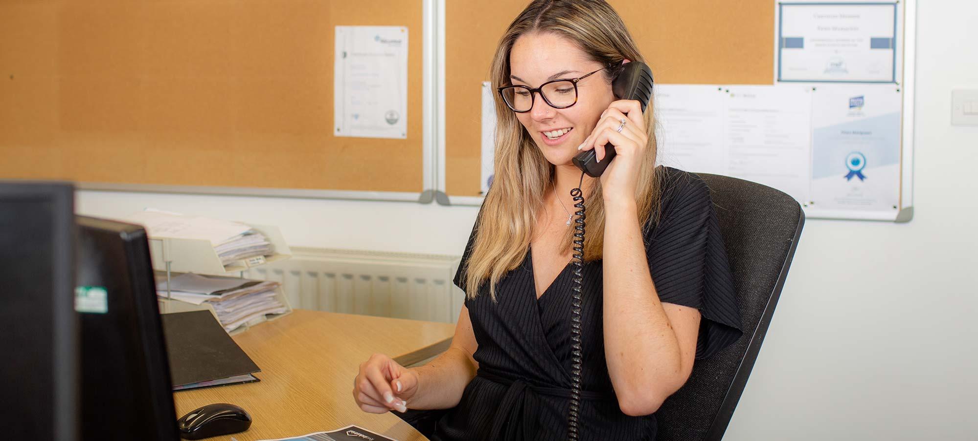 Fews office staff on telephone