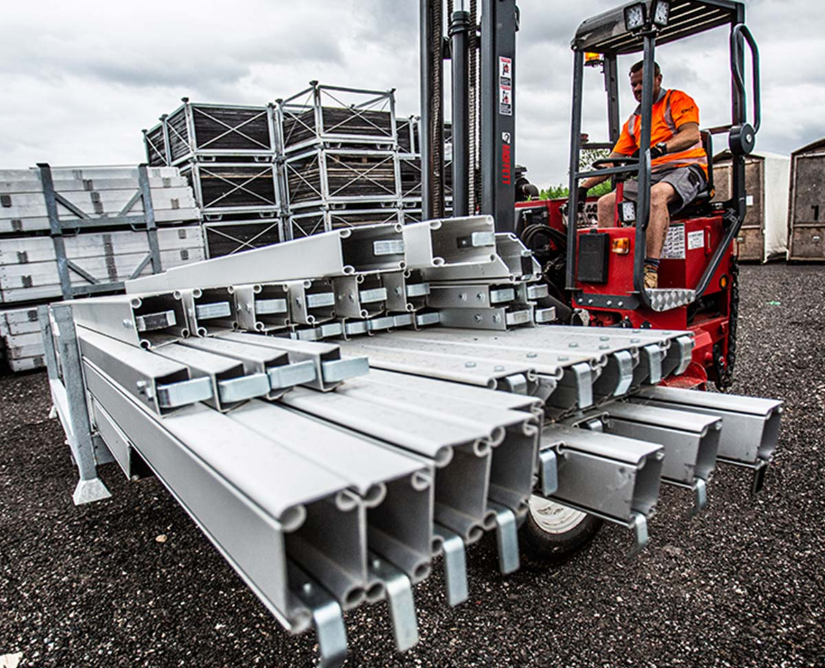 Forklift lifting marquee structure