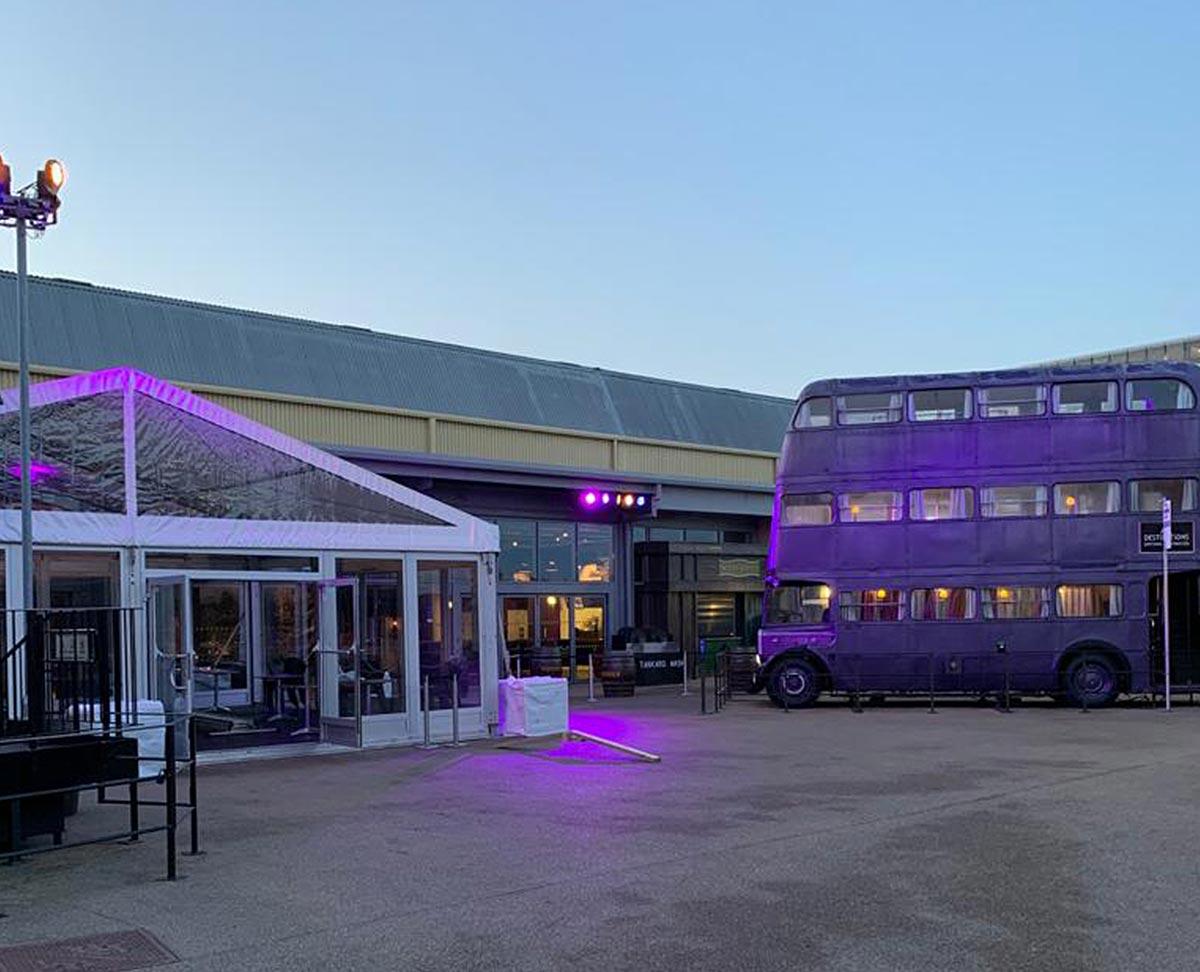 Purple bus outside Warner Bros studios